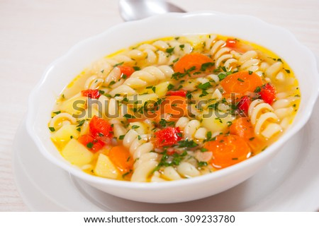 Fresh vegetable soup with pasta - stock photo