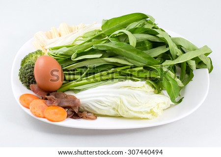 fresh vegetable with leaves on white background - stock photo