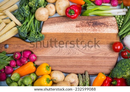 fresh vegetables and chopping board - stock photo