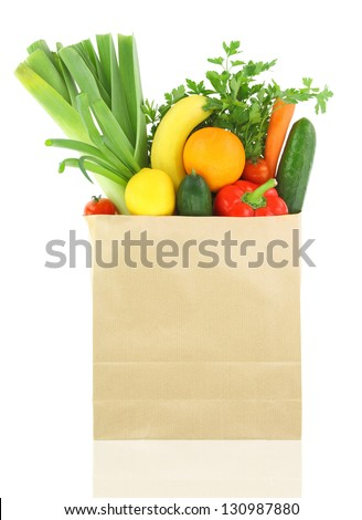 Fresh vegetables and fruits in a paper grocery bag - stock photo