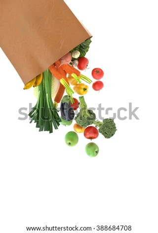 Fresh vegetables and fruits in a paper grocery bag - isolated over white background  - stock photo