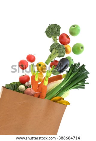 Fresh vegetables and fruits in a paper grocery bag - isolated over white background