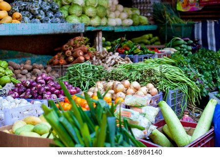 Fresh vegetables and fruits on asian market - stock photo