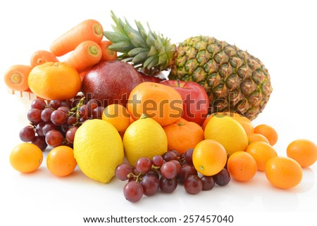Fresh vegetables and fruits on white background - stock photo