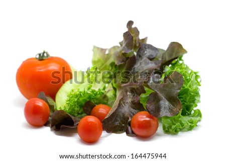 Fresh vegetables and green salad isolated on white background