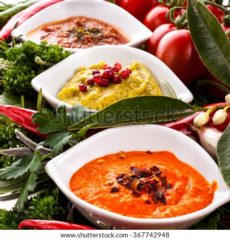 fresh vegetables and herbs and cooking sauces in white bowl isolated on a white background - stock photo