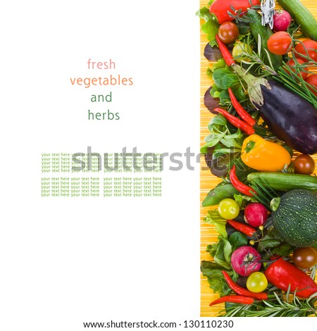 fresh vegetables and herbs on a yellow mat isolated on a white background with sample text
