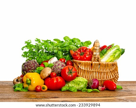 fresh vegetables and herbs on wooden background. raw food ingredients. shopping basket - stock photo