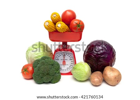 Fresh vegetables and kitchen scales on a white background close-up. horizontal photo. - stock photo