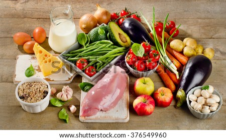 Fresh Vegetables and Meats for Healthy Diet on rustic wooden table.