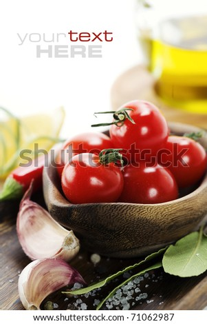 fresh vegetables and olive oil over white. With sample text - stock photo