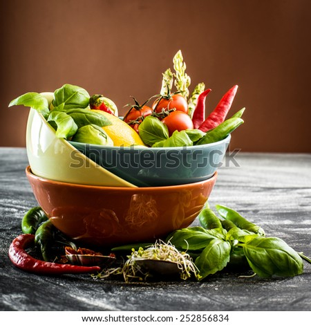 Fresh vegetables and spices in a bowl on the table