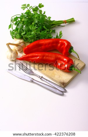 Fresh vegetables and spices on a white table. - stock photo