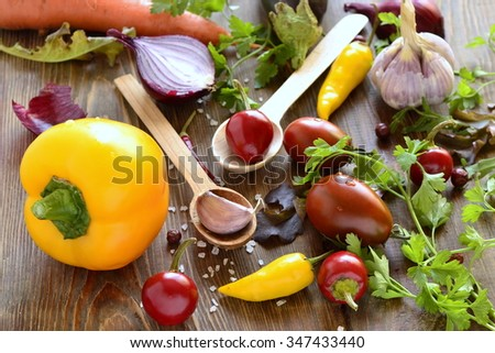Fresh vegetables and spices on wooden background. Vegetarian meal, healthy eating concept