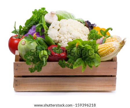 Fresh vegetables and spicy herbs in wooden box  isolated on white background  - stock photo