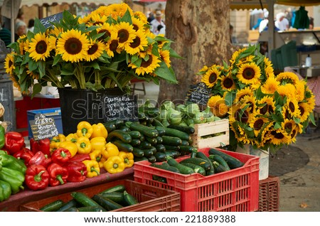 Fresh vegetables and sunflower blossoms for sale at farmers market in Aiv en Provence, France - stock photo