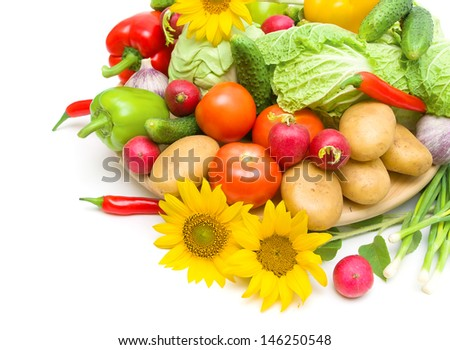 fresh vegetables and sunflower close-up on a white background. horizontal photo.
