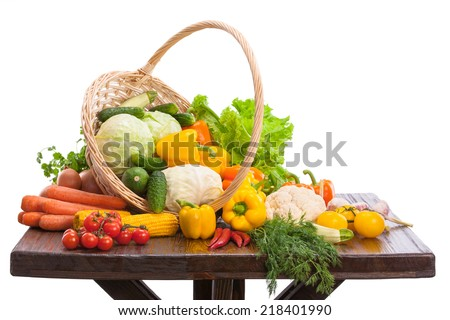 Fresh vegetables are in the basket on the table  - stock photo
