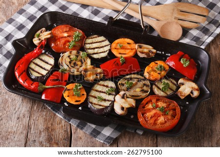 Fresh vegetables cooked in a black skillet grill closeup. Horizontal  - stock photo