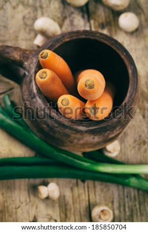 Fresh vegetables. Cooking ingredients. Carrots, onions and mushrooms - stock photo