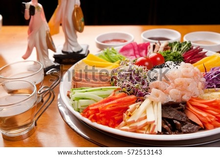 Fresh vegetables, delicious meat, rice noodles, rice wrapped with rice paper
