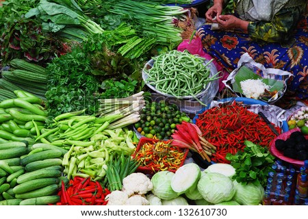 Fresh vegetables for sale on asian market. Pasar Siti Khadijah market, Malaysia - stock photo