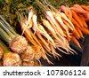 Fresh vegetables for soup on market stall - stock photo