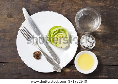 fresh vegetables, fruit and nuts on wooden table