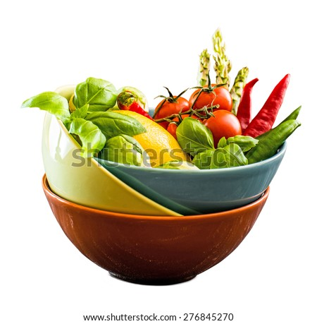 Fresh vegetables in a bowl isolated on a white background - stock photo