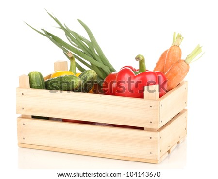 Fresh vegetables in crate isolated on white - stock photo