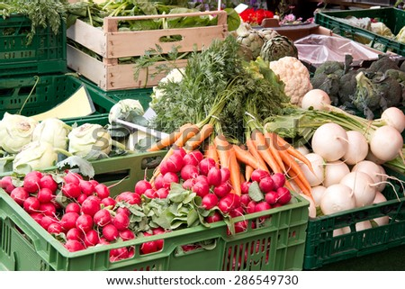 Fresh vegetables in crates at a farmers market - stock photo