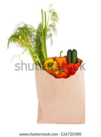 fresh vegetables in shopping bag isolated on white background