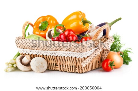 Fresh vegetables in wicker basket. Isolated on white background - stock photo