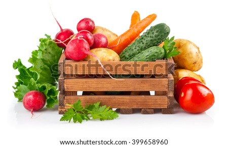 Fresh vegetables in wooden box. Isolated on white background - stock photo