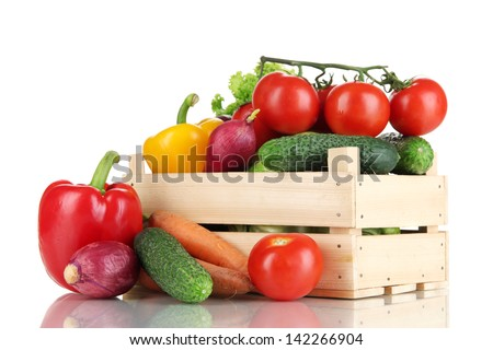 Fresh vegetables in wooden box on white background - stock photo