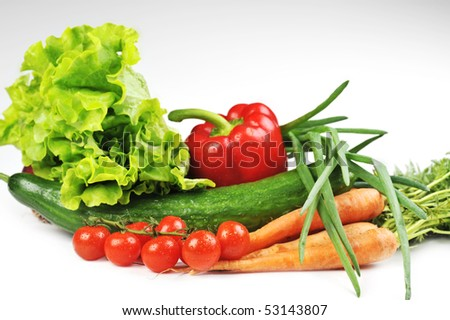 fresh vegetables. Included are  tomatoes, carrots, cucumber, onions - stock photo