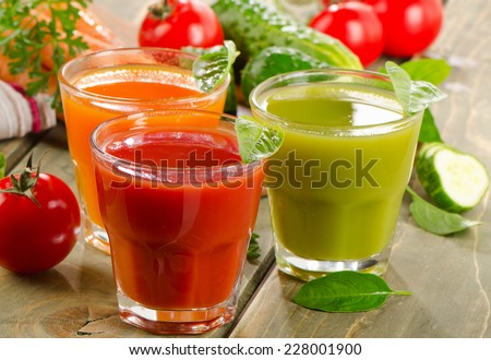 Fresh vegetables  juices on  wooden table. Selective focus