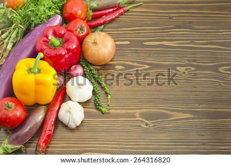 Fresh vegetables mix on wood plank - stock photo