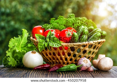 Fresh vegetables on a brown background  on an old wooden table