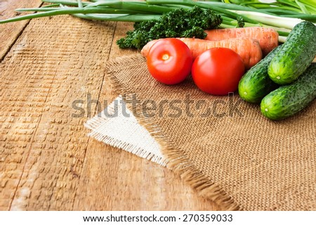 Fresh vegetables on a burlap on wooden table