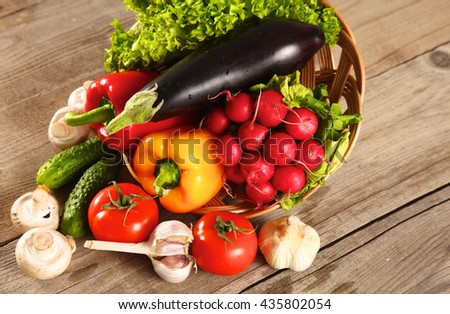 Fresh vegetables on a clean wooden table