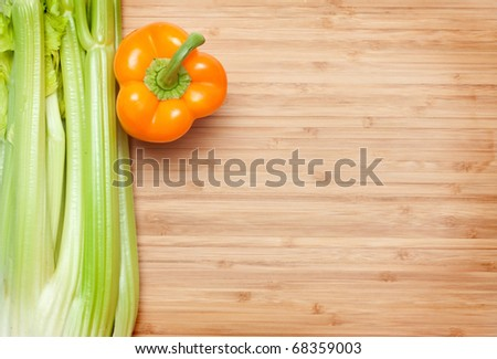 fresh vegetables on a cutting board - stock photo
