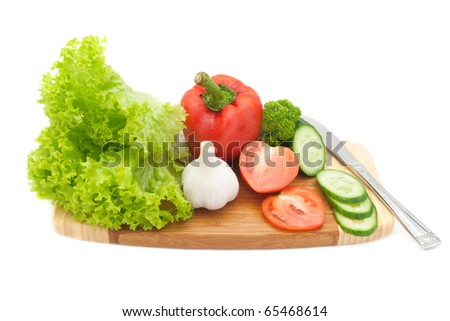 fresh vegetables on a cutting board isolated on white - stock photo