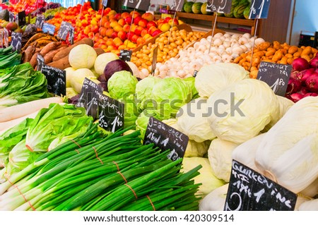 Fresh vegetables on a farmers market stall - stock photo