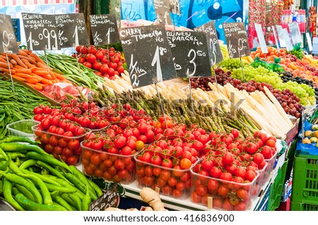 Fresh vegetables on a market stall - stock photo