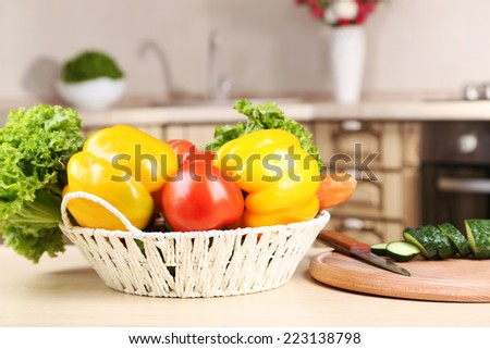 Fresh vegetables on a table in the kitchen - stock photo