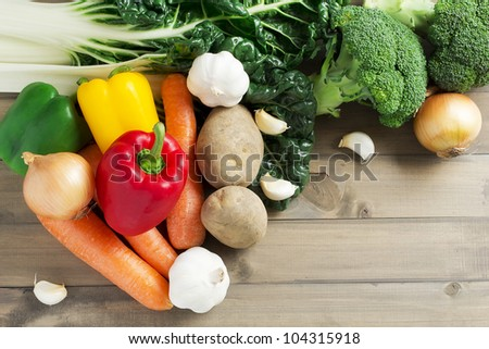 Fresh vegetables on a wooden background - stock photo