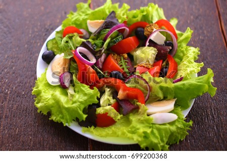 Fresh vegetables on a wooden table. Healthy food. Diet