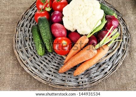 Fresh vegetables on burlap background - stock photo