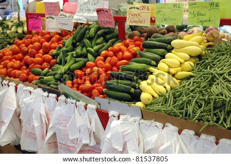 Fresh vegetables on display at a farmer's market - stock photo